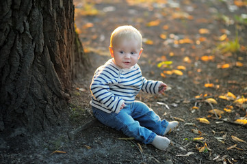 Little baby at the autumn park