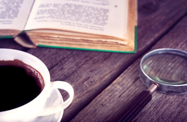 Cup Of Coffee and book on wooden background