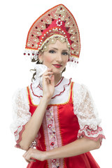 Smile coquettish young woman portrait  in russian traditional co