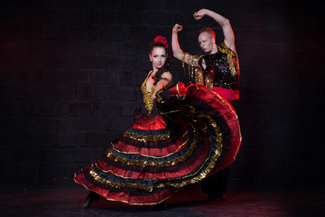 Young couple dancing flamenco, studio shot