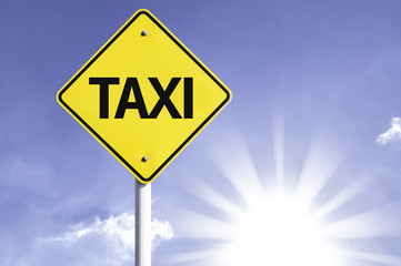 Taxi road sign with sun background