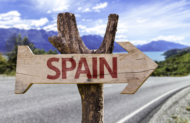 Spain wooden sign with a street background