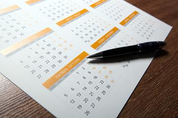 wall calendar with pen closeup