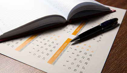 wall calendar with pen and diary closeup