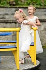 Bridesmaids playing on playground