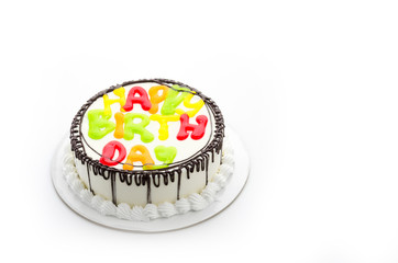 Happy birthday cake isolated on white