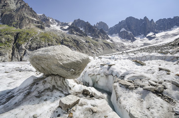 Alpine landscape with cracked glacier and mountains