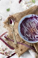 eaten purple carrot cream soup on empty bowl with carrot peels
