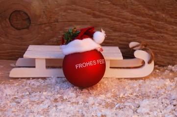 Weihnachtskugel mit Schlitten - Frohes Fest