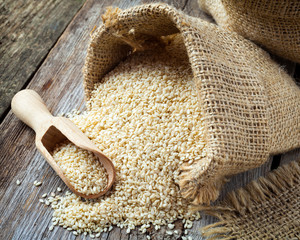 sesame seeds in sack on  rustic table