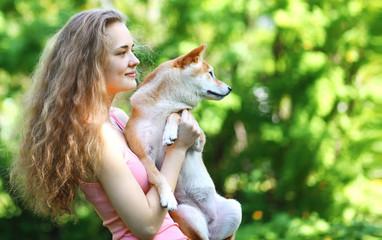Happy owner walking dog summer