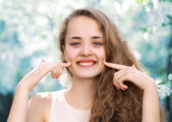 Young charming funny girl cute smiling with dimpled in warm spri