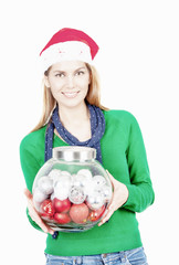 Woman with red hat showing transparent box with Christmas balls