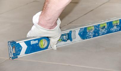Tiler checking the level