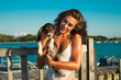 puppy and girl at seaside