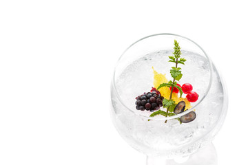 Gin hard liquorl drink with berries fruits isolated on white