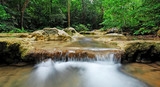 Waterfall with blue stream in the nature Thailand forest poster