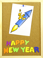 Happy New Year phrase on a corkboard