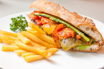 vegetables sandwitch serve with fried potato