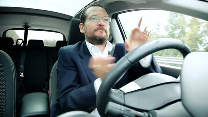 Funny business man dancing in car