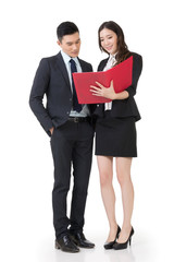Asian business man and woman discussing