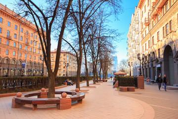 People walking on the sidewalk on Lenin Street in spring in Mins
