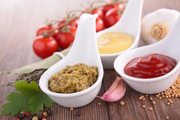 mustard, ketchup and pesto sauce