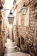 Leinwanddruck Bild - Steep stairs and narrow street in old town of Dubrovnik