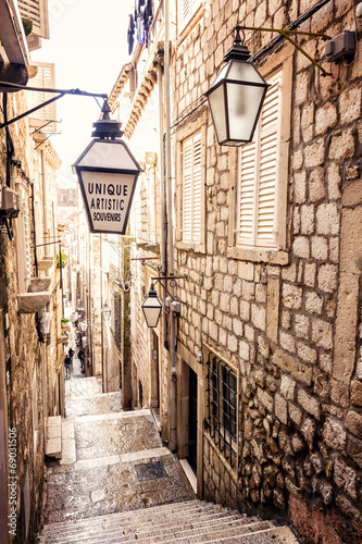 Leinwanddruck Bild Steep stairs and narrow street in old town of Dubrovnik