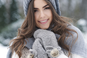 Beautiful woman loving nature during the winter