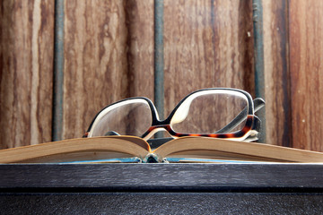eyeglass on a book