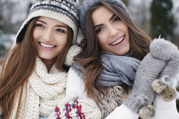 Winter portrait of fashion female friends