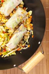 Preparing to serve spring rolls to eat