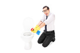 Man cleaning a toilet with disinfecting spray poster