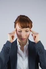 Stressed businesswoman getting a headache
