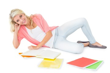 Pretty young blonde lying and studying