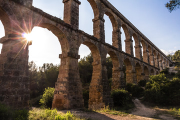 Ancient Roman aqueduct on sunset, Tarragona, Spain