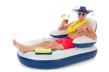 Floating in chair in swimming pool