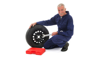 mechanic with wheel and wrench