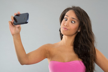 Black woman taking funny selfie