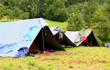 camping tents in a scout camp and drying laundry out