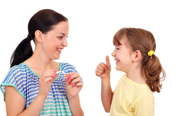 girl breaks a cigarette and a little girl with thumb up