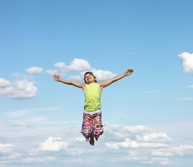 happy little girl flying in the sky