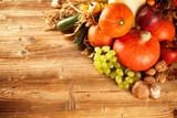 Fototapety Autumn harvested fruit and vegetable on wood