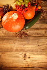 Autumn harvested fruit and vegetable on wood
