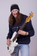 talented musician playing bass guitar