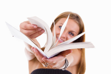 happy female student flipping a book