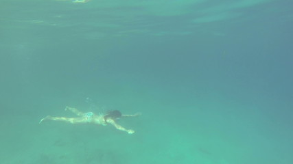 Lady Diving Underwater