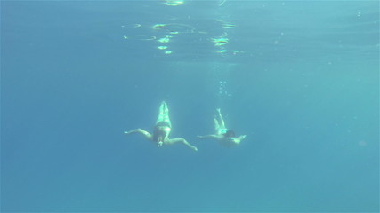 Lady Divers Diving Underwater