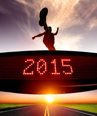 happy new year 2015.runner jumping and crossing over matrix